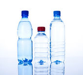 Three Bottles water over a white background — Stock Photo
