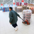 Worker in supermarket — Stock Photo