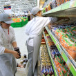 Worker in supermarket - Stock Photo