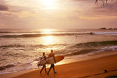 Couple of surfers — Stock Photo
