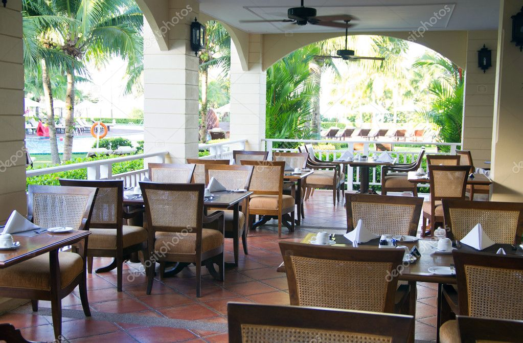 Outdoor restaurant at green garden  Stock Photo #9862026
