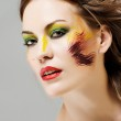 Portrait of a beautiful girl with a color make-up — Stock Photo