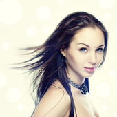 Portrait of a beautiful young woman with hair flying — Stock Photo