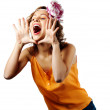 Young blonde woman shout and scream using her hands as tube — Stock Photo