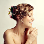 Beauty woman portrait, hairstyle with flowers — Stok fotoğraf