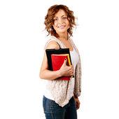 Fille heureux jeune étudiant tenant des livres, — Photo