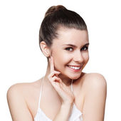 Beautiful young woman with clean skin of the face. — Stock Photo