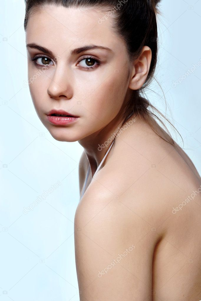 Close-up portrait of sexy caucasian young woman with beautiful brown eyes  Stock Photo #9342877