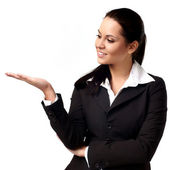 A young beautiful business woman pointing at copyspace — Stock Photo