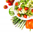 Salad with tomatoes and green leaves isolated on white — Stock fotografie