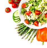 Salad with tomatoes and green leaves isolated on white — Foto de Stock