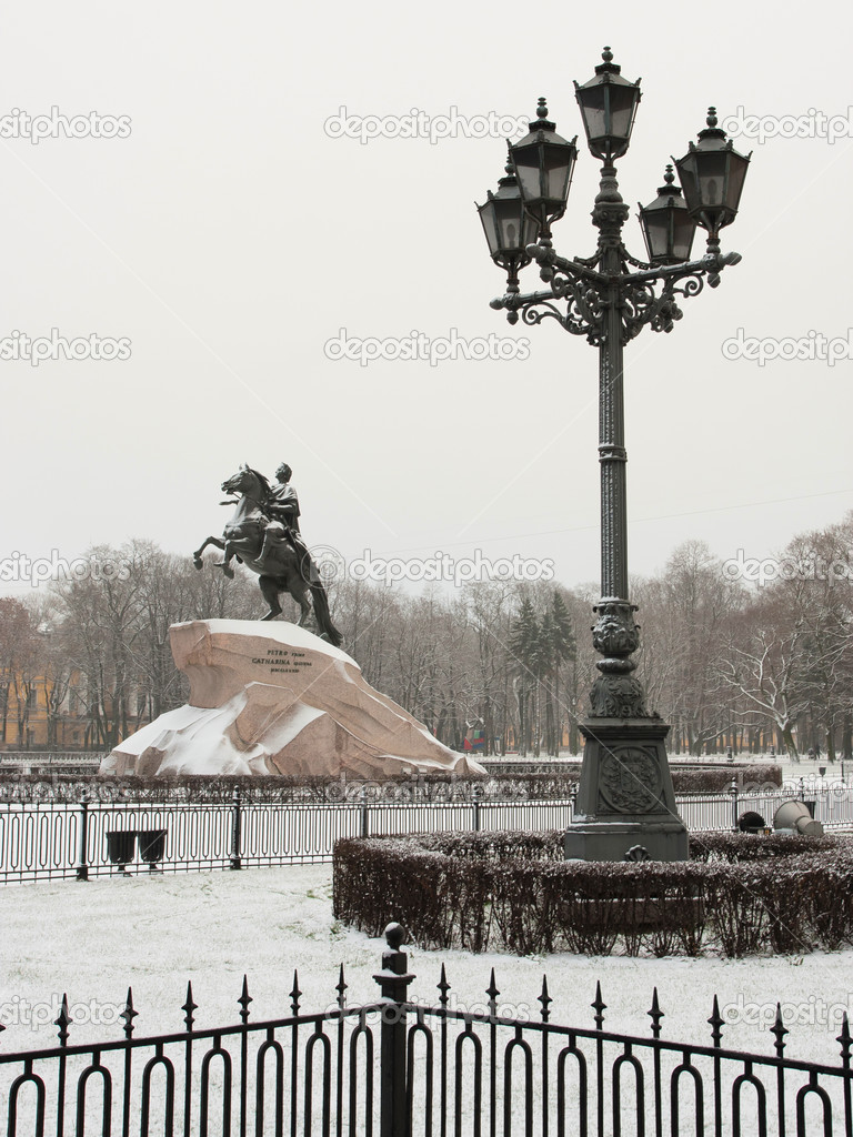 The image of street lamp in St. Petersburg and Piter The Thirst monument, goes under the name of Copper horseman. On the 14-th of december 1825 there was the de — Stock Photo #8244629