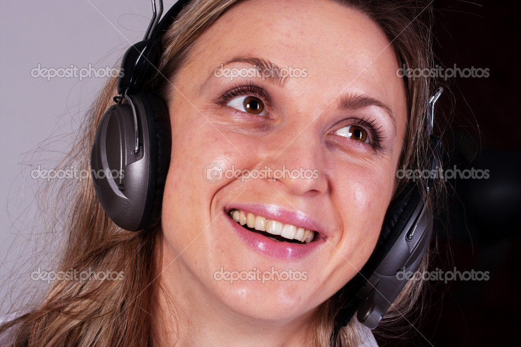 The image of girl with earphones  Stock Photo #8774865