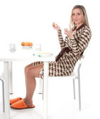 Girl sits at the table — Foto Stock