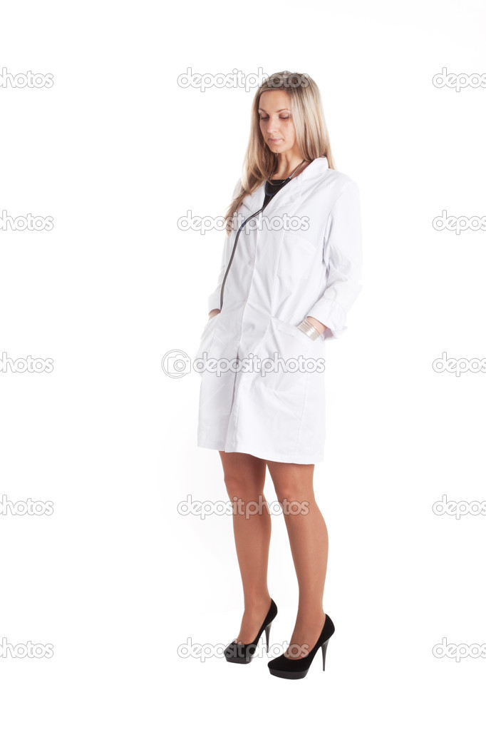 Thoughtfu woman doctor with stethoscope in a white robe — Stock Photo #8946770