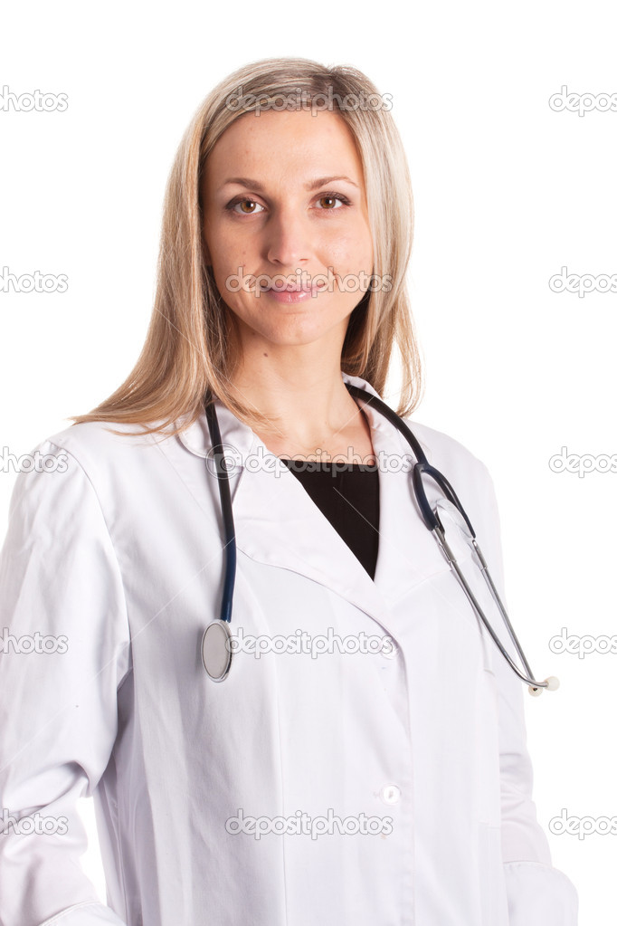 Standing woman doctor with stethoscope in a white robe  Stock Photo #8946775