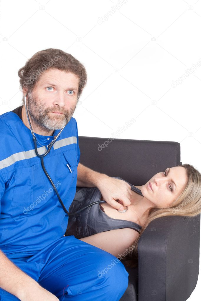The image of an emergency doctor in the blue suit examinegirl's chest  Stock Photo #9306399