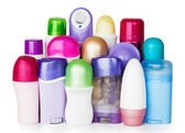 Plastic cosmetics bottles on white background — Stock Photo