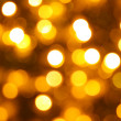 Gold christmas lights background — Stock Photo