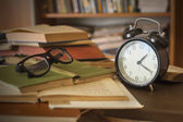 Books with clock — Stock Photo