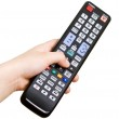 Hand with remote control — Stock Photo