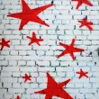 Red Stars on White Brick Wall — Stock Photo