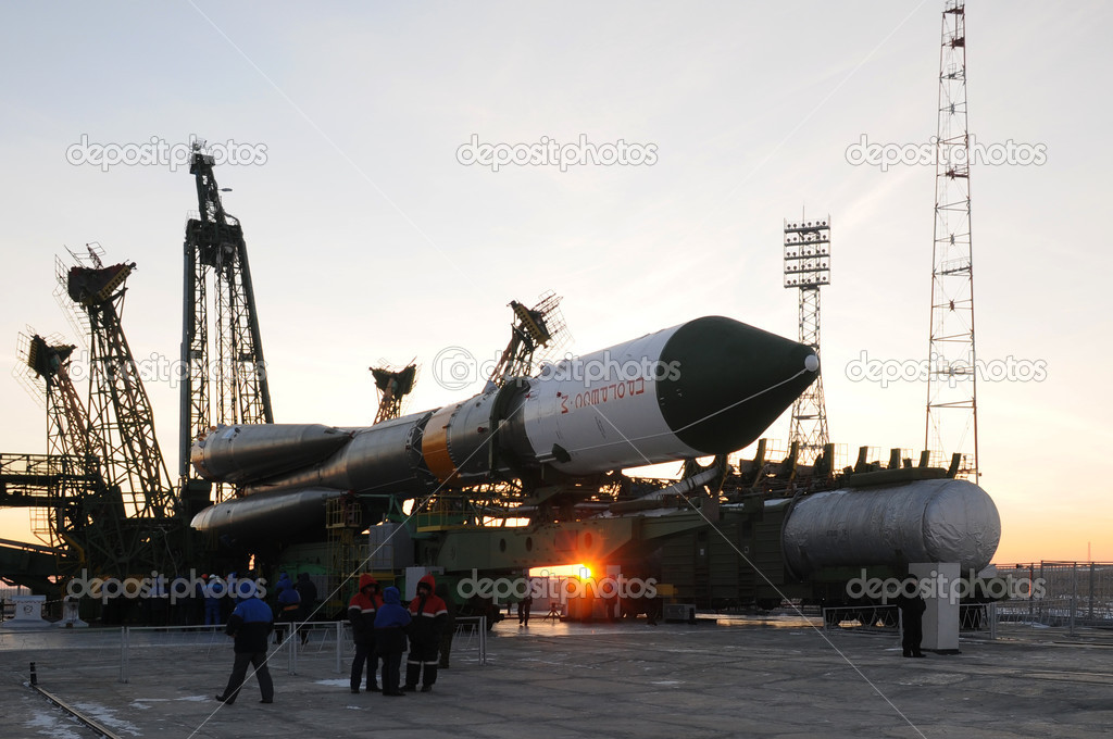 BAIKONUR, KAZAKHSTAN - JANUARY 26: Progress cargo spacecraft is being elevated on the launch tower at sunrise January 26, 2011 at Baikonur cosmodrome, Kazakhsta  Stock Photo #9199952