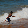Running Away from the Wave — Stock Photo