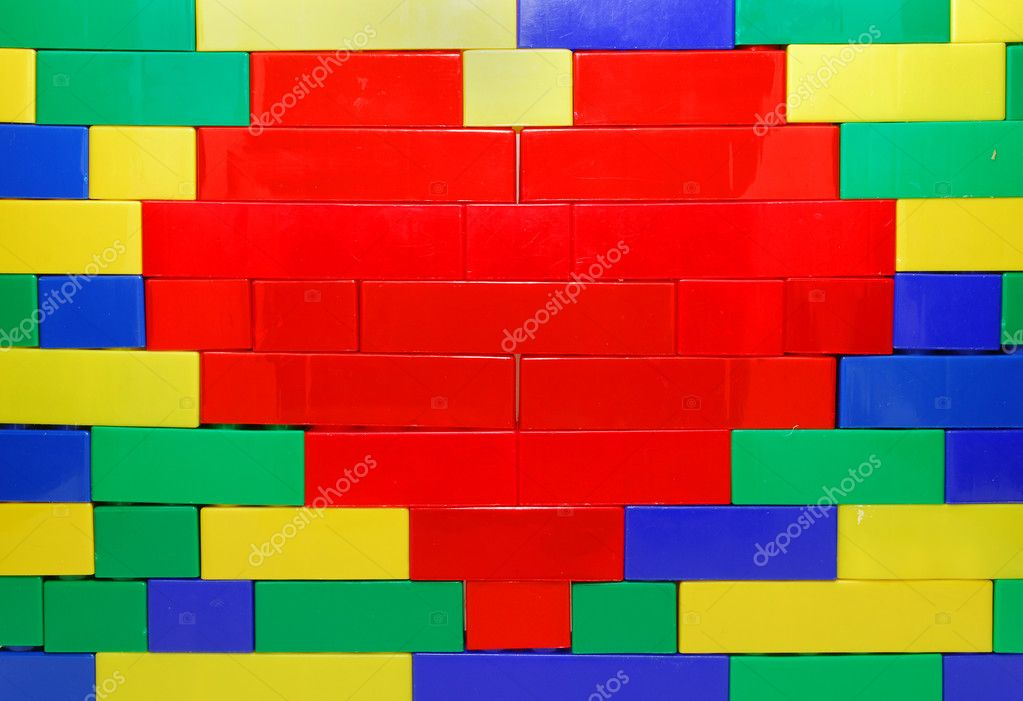 Red Heart Shape of Lego Blocks on the Lego Wall — Stock Photo #8626293