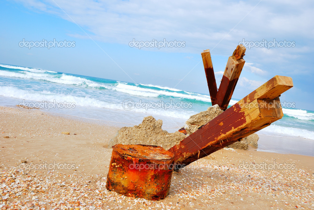 The rests of the destroyed house on sea coast — Stock Photo #8740746