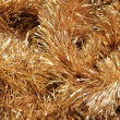 Christmass golden tinsel background — Stock Photo