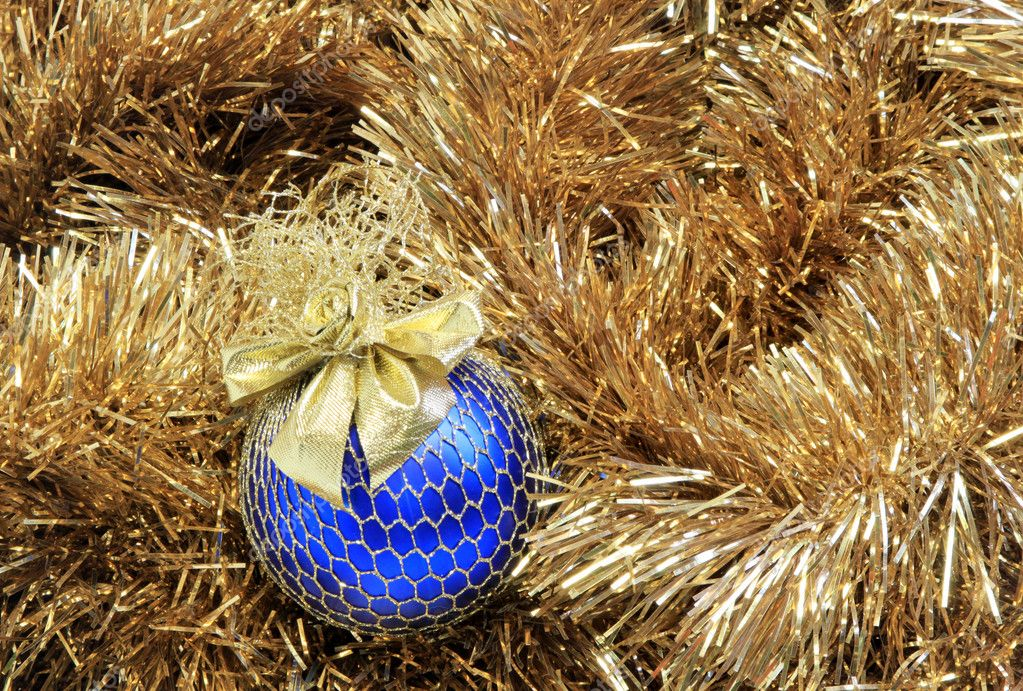 Blue christmas ball on a golden tinsel — Stockfoto #9265358