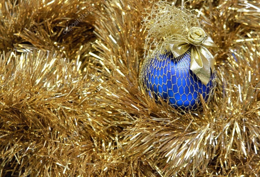 Blue christmas ball on a golden tinsel — Stock Photo #9265819