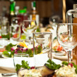 Glasses and plates on table in restaurant - food background — Stock Photo #10544107