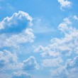 White fluffy clouds in the blue sky — Stock Photo