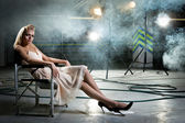 Girl on a chair — Stock Photo