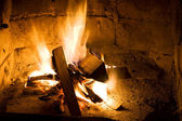 Burning wood in a fireplace — Stock Photo