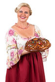Woman with a round loaf — Stock Photo