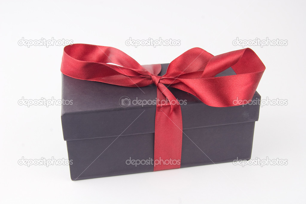 Gift box with a red bow and ribbon - on white background — Stock Photo #9636876