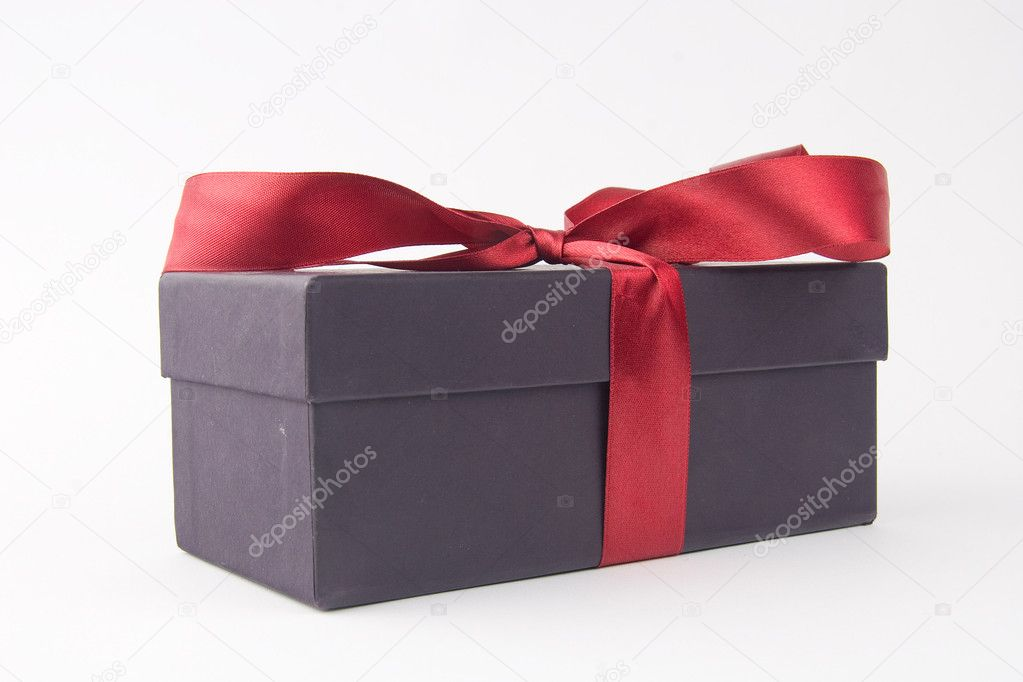 Gift box with a red bow and ribbon - on white background — Stock Photo #9636884