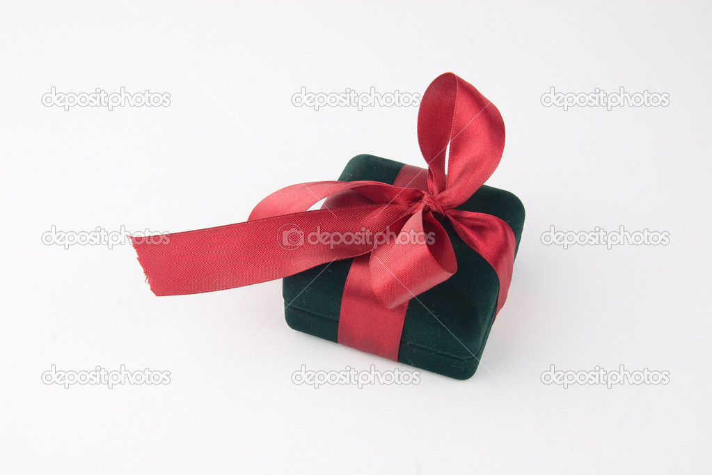 Gift box with a red bow and ribbon - on white background  Stock Photo #9636904