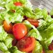 Salad with cheery tomatoes and green leaves — Stock Photo #9704269