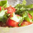 Salad with cheery tomatoes and green leaves — Stock Photo #9822407