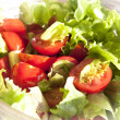 Salad with cheery tomatoes and green leaves — Stock Photo #9866811