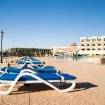 Beach lounges near the 5-star hotel — Stock Photo