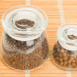 Pepper in a glass jar - Stockfoto