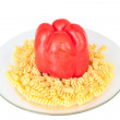 Macaroni in a transparent plate on straw mat - Stock Photo