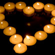 图库照片: Heart of candles