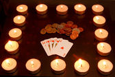 Cards, coins & candles — Stock Photo