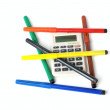 Felt-tip pens and calculator — Stock Photo